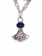 "Sterling Silver with High domed oval Lapis and ceramic 'cabochon' pendant. Hand fabricated bezel and backplate. 18"" brushed silver, irregular link chain with sliver lobster clasp."