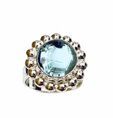 Sterling silver ring with with round Blue Topaz cabochon, with beaded edging