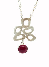 Retro shapes silver pendant with carnelian.