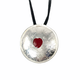 Sterling silver and red enamel heart pendant on an adjustable black suede cord