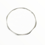 Hand forged sterling silver bangle, faceted