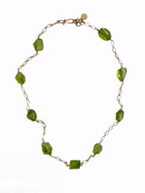 Necklace, 14k yellow gold chain w/handmade clasp, and large irregularly cut peridot beads. Perfect for day or evening, summer and all year round, with t-shirts or velvet. Length 16.5 in. One of a kind, by J A lindberg.