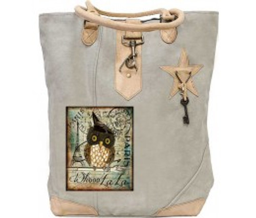 This roomy tote is made from recycled tent canvas with a colorful patch, decorative key, metal clasp and  leather handles long enough to carry over your shoulder. The interior is lined with striped cotton and has a small pocket for things you want to reach quickly.