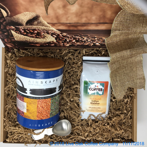 Ceramic canister with coffee and scoop. Also available with a Stainless Steel canister in Red, Turquoise or Mocha.  Ceramic canister is available in Pearl Grey or Cobalt Blue.