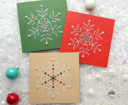 packs of Christmas cards handmade snowflakes