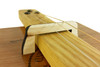 "This photos shows the hard maple version of these bridges in use on a ""stick on top"" cigar box guitar."