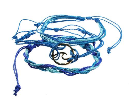 set of 3 adjustable blue strand bracelet one with gold coloured wave charm