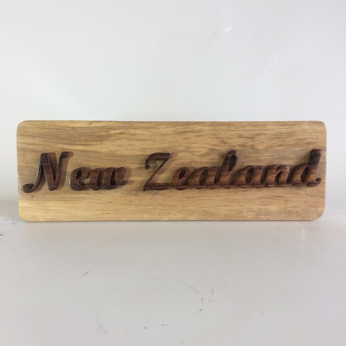 """Wooden words """"New Zealand"""" on 30cm long piece of wood plank"""