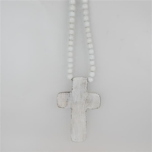 hanging white washed wooden cross