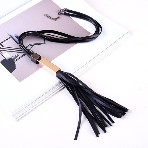 black multi strap necklace with gold tube and pu leather tassel