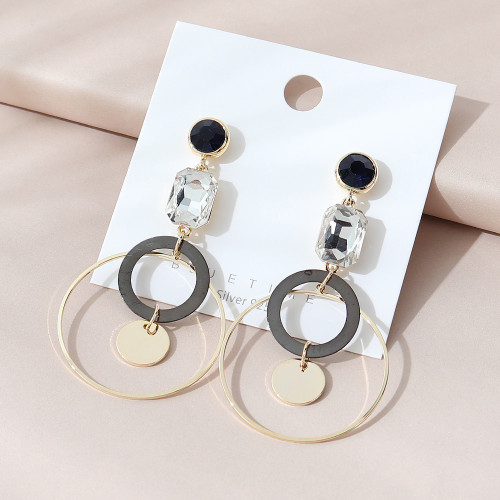 rings and circles suspended beneath gems onstud  posts earring