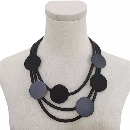 Hand finished  rubber necklace with round metal and rubber shapes (asstd colour combinations)