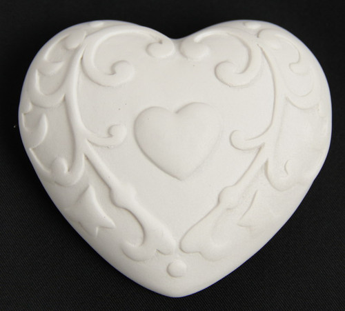 white heart ornament with a small heart in pattern