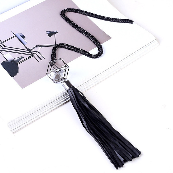 one piece black chain with 3D hollow geometric shape with crystal inside and black PU leather tassel