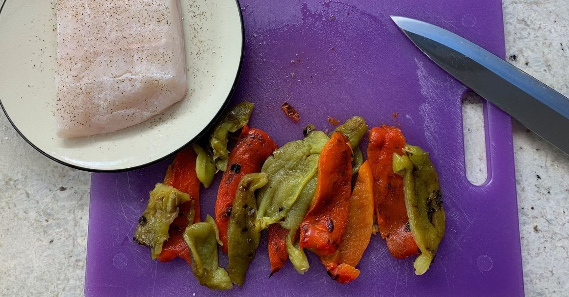 OLIVE OIL-POACHED HAKE AND BELL PEPPERS