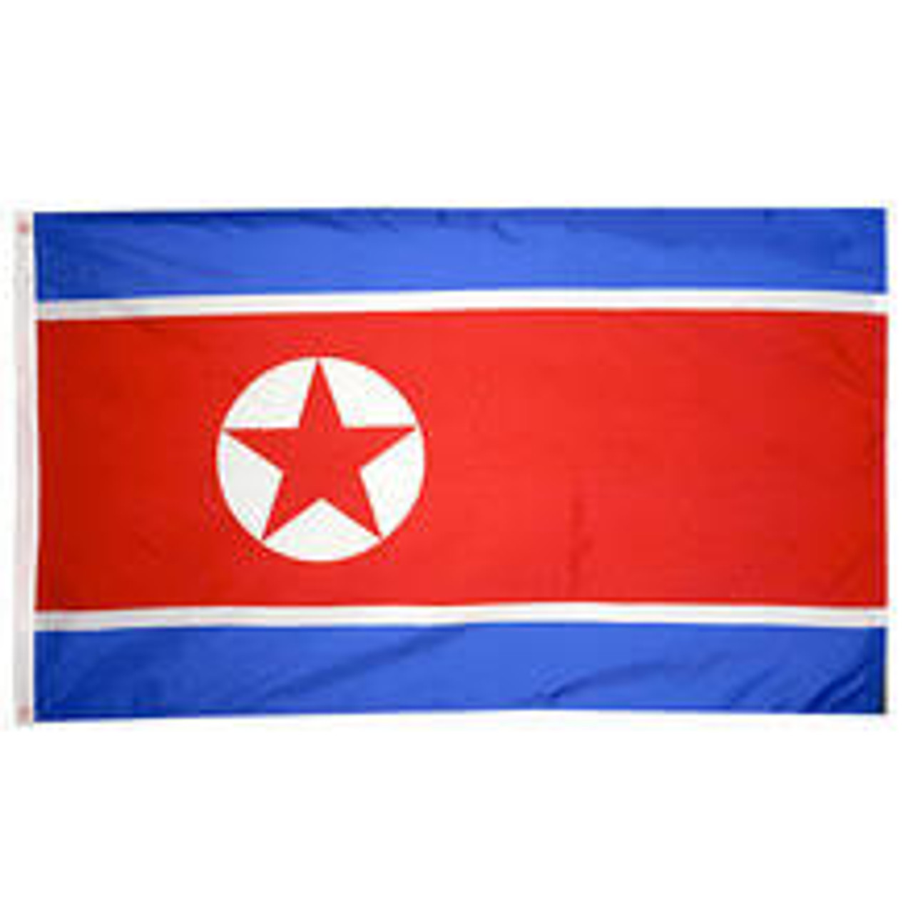 A North Korean flag made of nylon with lock stitching, polyester canvas heading, and brass grommets. Design is a central red panel, bordered above and below with narrow white stripes and broad blue stripes with an emblem of a red star surrounded by a white circle centered slightly left.