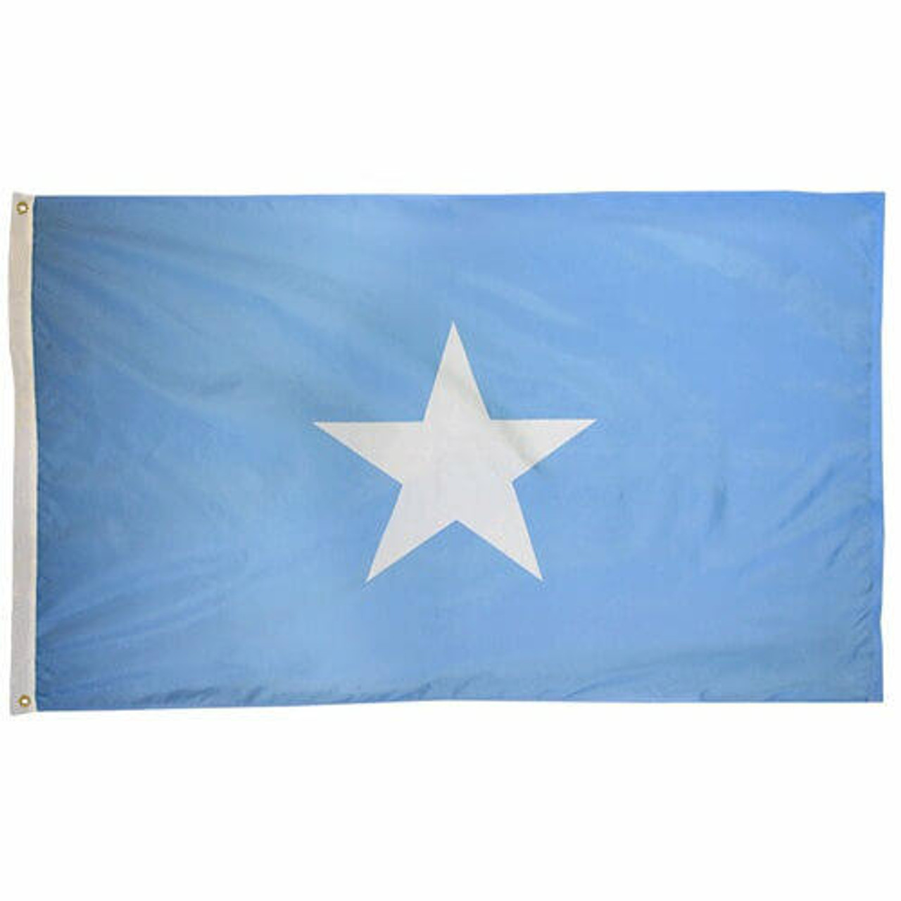 Somalia Flag with light blue background and white five point star at center. White header and brass grommets.