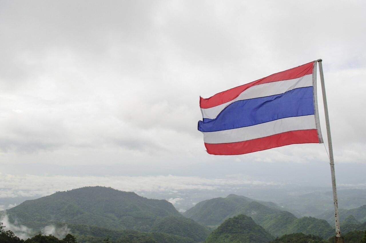 Thailand Flag flying in front of landscape