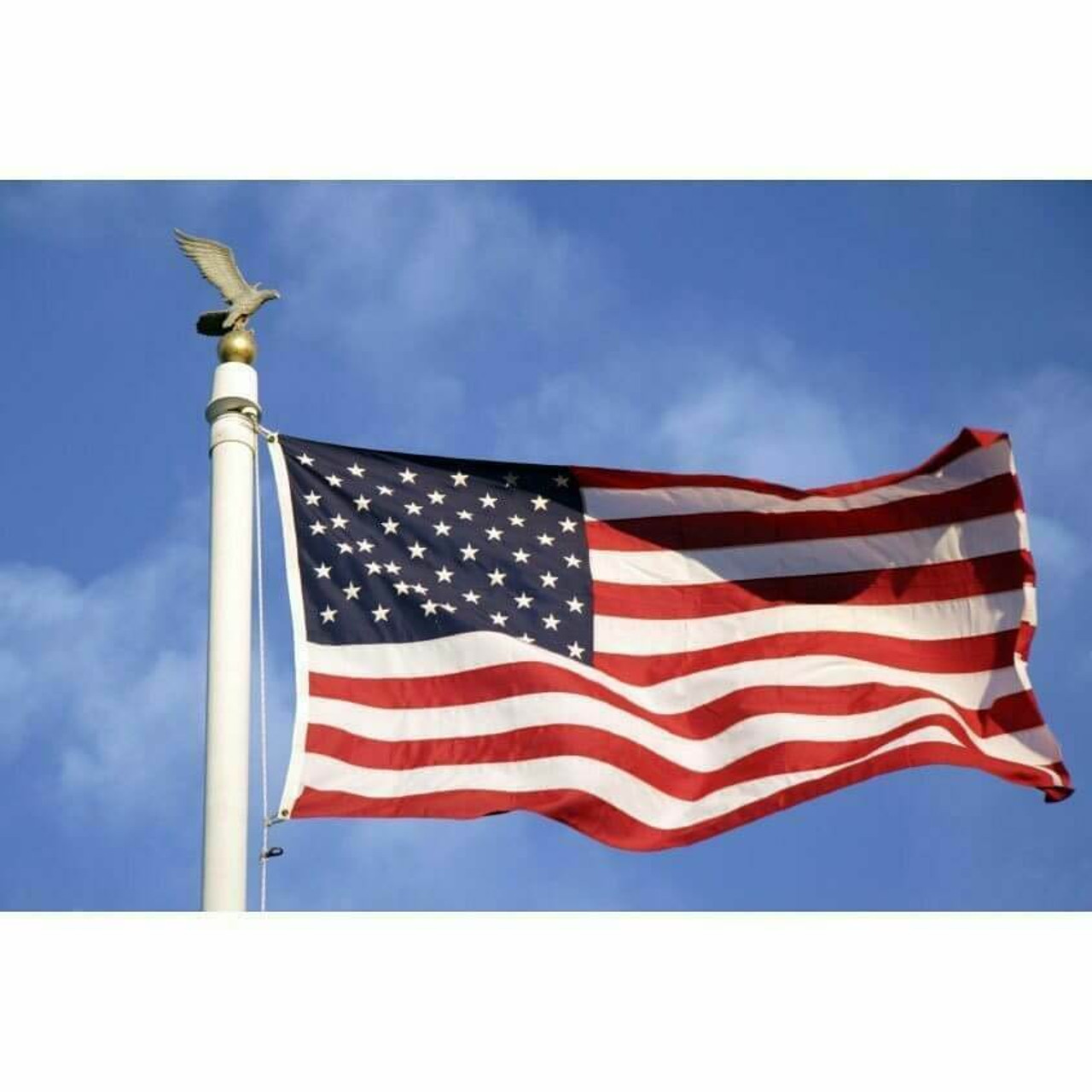 Nylon American flag flying on an outdoor flagpole 30' tall on a sunny fall day in Omaha.