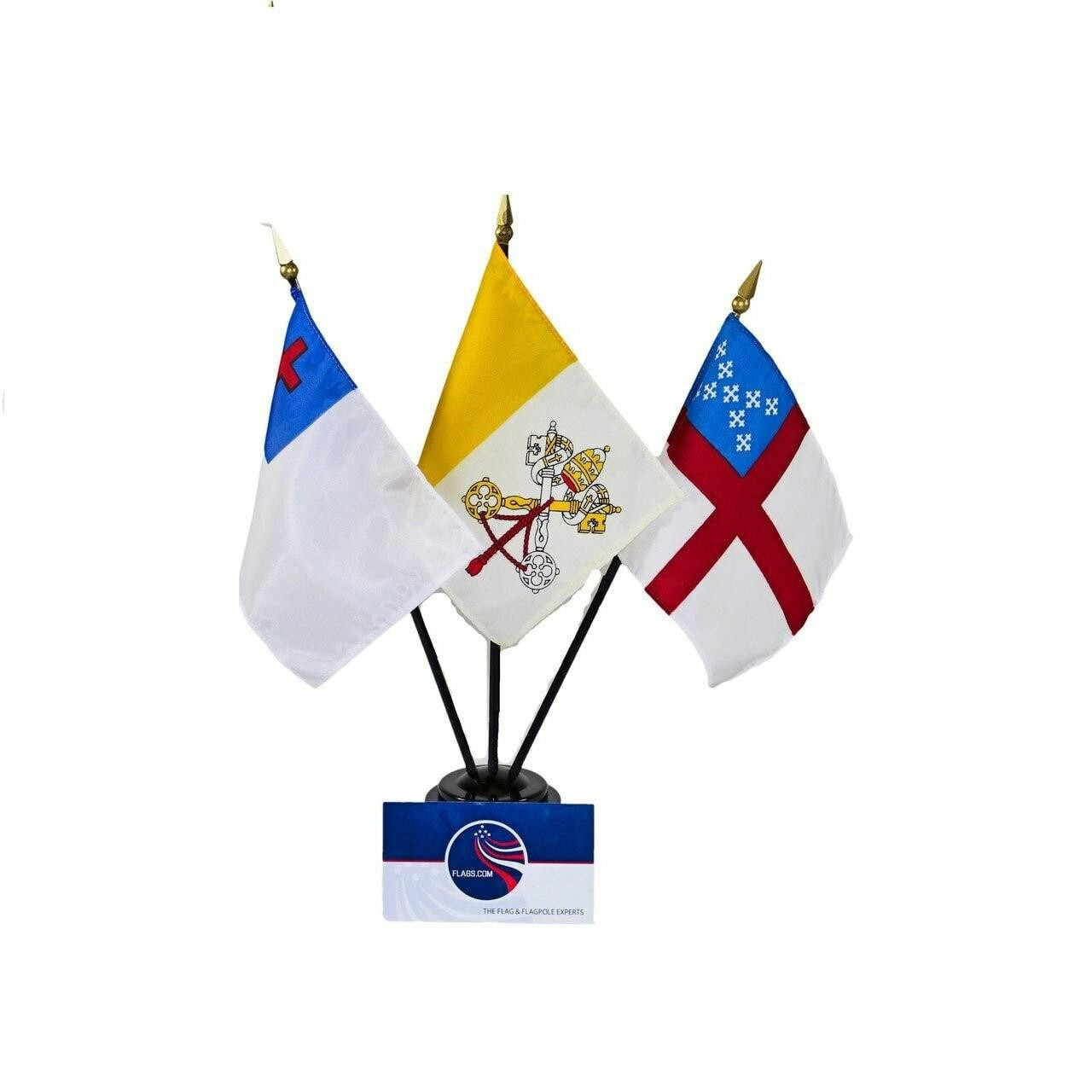 Three religious flags in one black plastic base. The Christian flag features a white background with a blue field in its top left corner. Inside the blue field is a red Latin cross. The Episcopal flag consists of a white background with a red cross going across its center. In the top left corner is a blue field with nine small white Greek-style crosses with embellished ends, arranged in an X-shaped cross pattern. The Vatican flag features a white and yellow vertical bi-color pattern - yellow is on the left side, white on the right. Centered on the white side of the flag is an ornate yellow, silver and red design featuring a papal tiara, keys, priestly vestments, and religious cords. This is the coat of arms of the Vatican City.