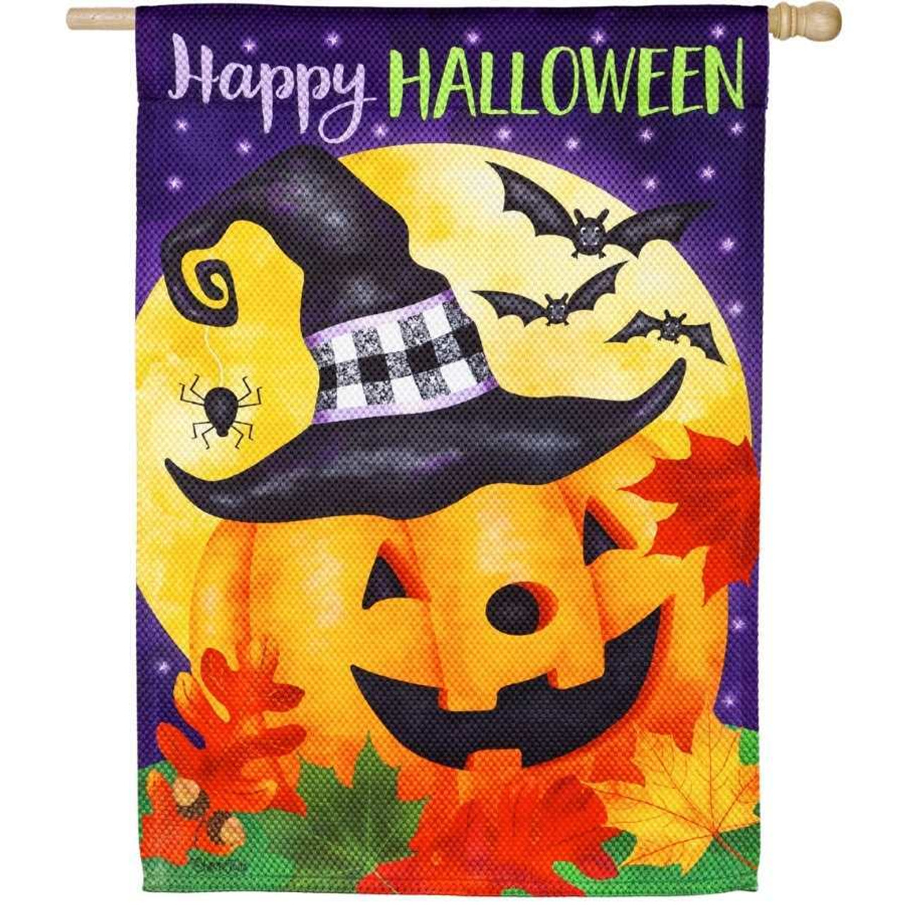 """A textured flag with a jack-o-lantern wearing a witches hat. A spider hangs from the hat. Fall-colored leaves are on the ground. A full yellow moon and bats are behind the pumpkin. The background is purple with white stars, and """"Happy Halloween"""" is written at the top."""
