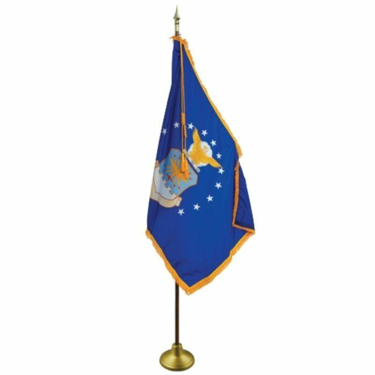 """The U.S. Air Force flag contains the U.S. Air Force's crest surrounded by thirteen white five-pointed stars on a blue field. The crest contains a golden eagle in clouds clutching a blue and white rope over a blue and white shield with a golden design on it. Beneath the shield is a white scroll reading """"United States Air Force"""" in golden lettering. It hangs at rest, attached to an ornate golden flagpole. The flag's sides not attached to the flagpole have golden fringes. A decorative gold cord and tassel sit at the top of the flagpole."""