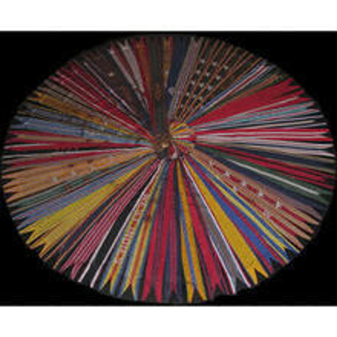Many colorful army streamers laid out in a circle with a black background.