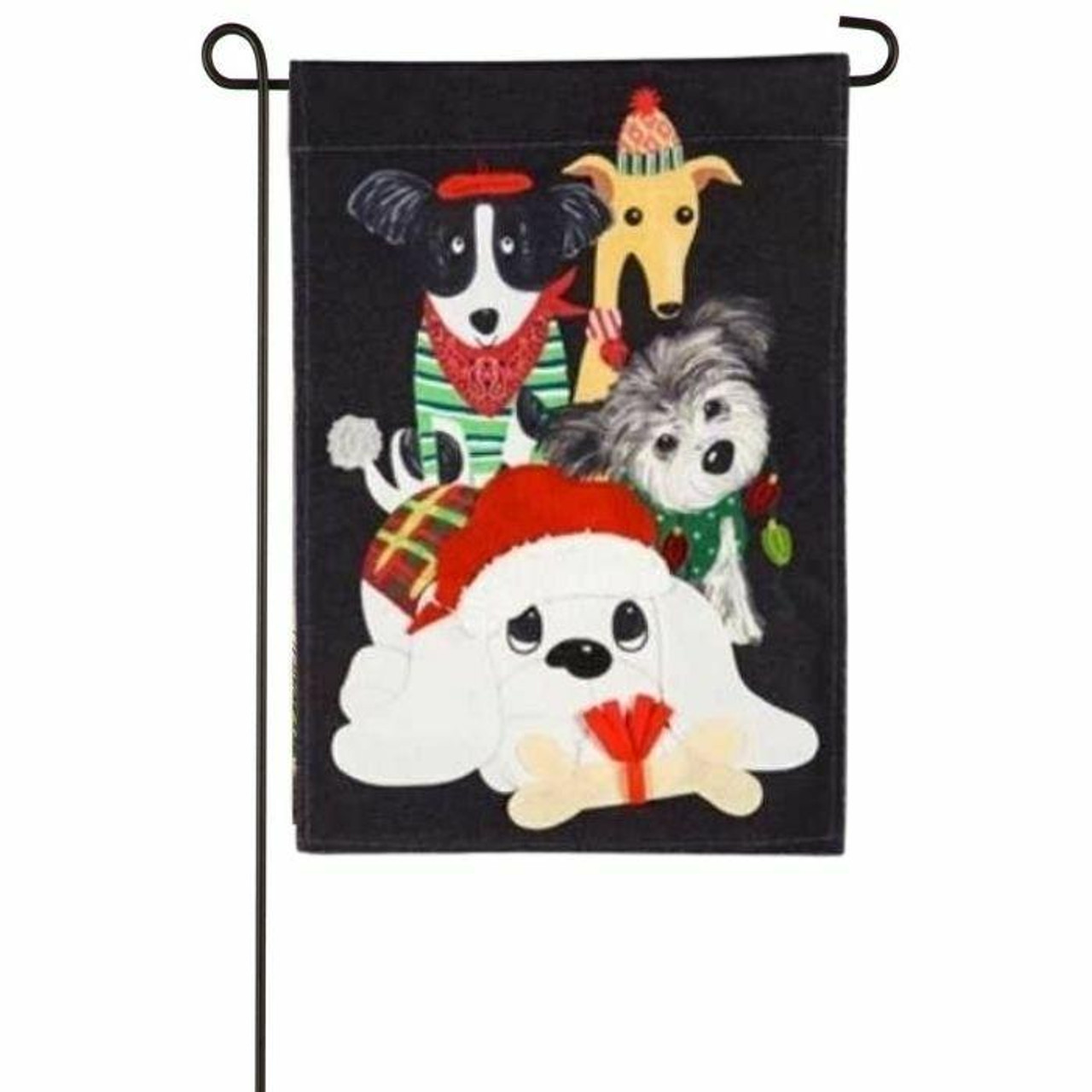 Illustrated Christmas house flag design featuring dogs dressed and decorated in Christmas Wear. White dog with red Christmas hat in center, holding an off-white bone with red Christmas bow on it. The White is also wearing a red, yellow, and green, plaid sweater. Behind the white dog is a fluffy dog gray and white dog in green sweater, along with a black and white dog in green sweater and red bandana, and a tan dog with a red and white striped scarf. The background of the image is black.
