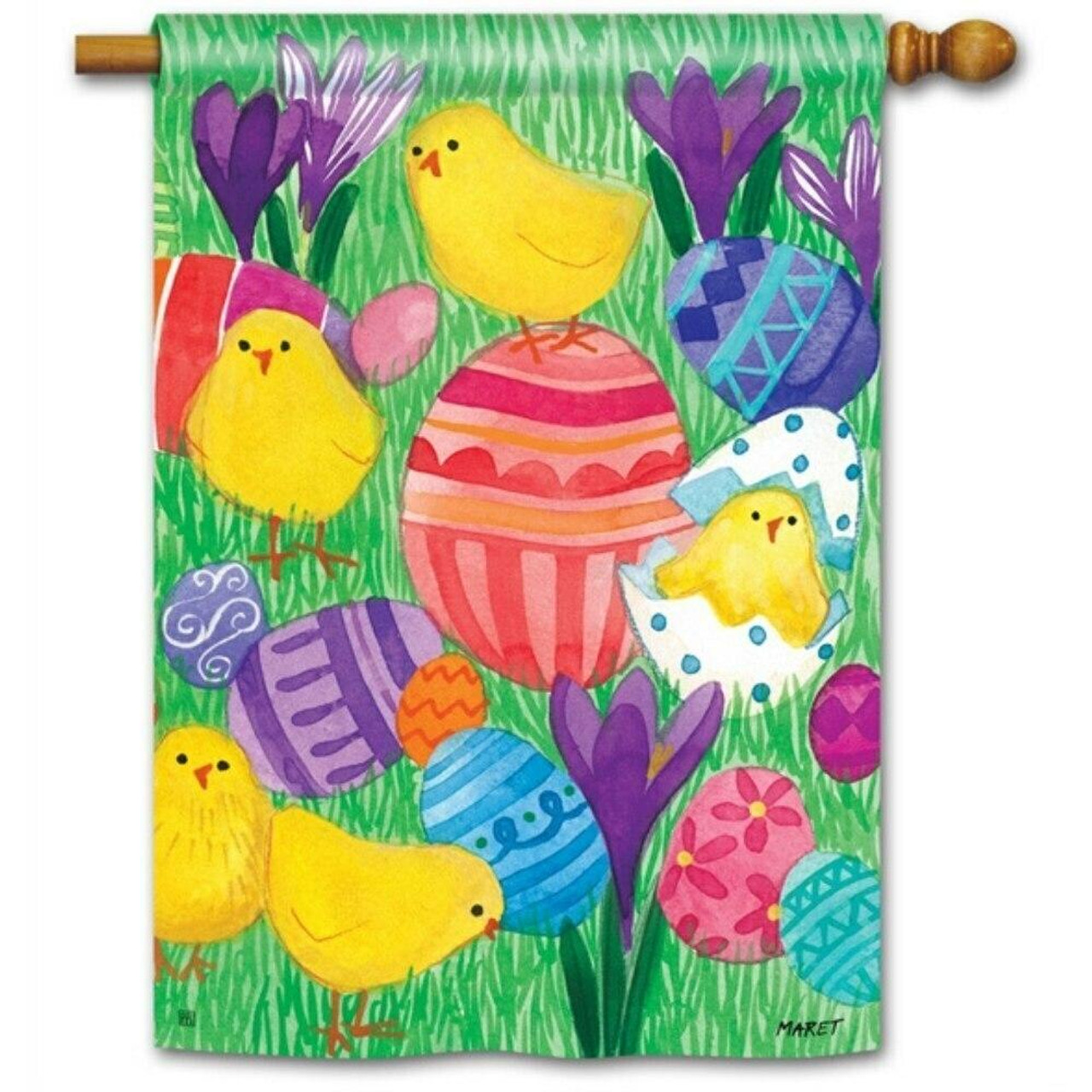 This house flag features green grass as the background with yellow chicks and pink, blue, and purple eggs throughout the design.