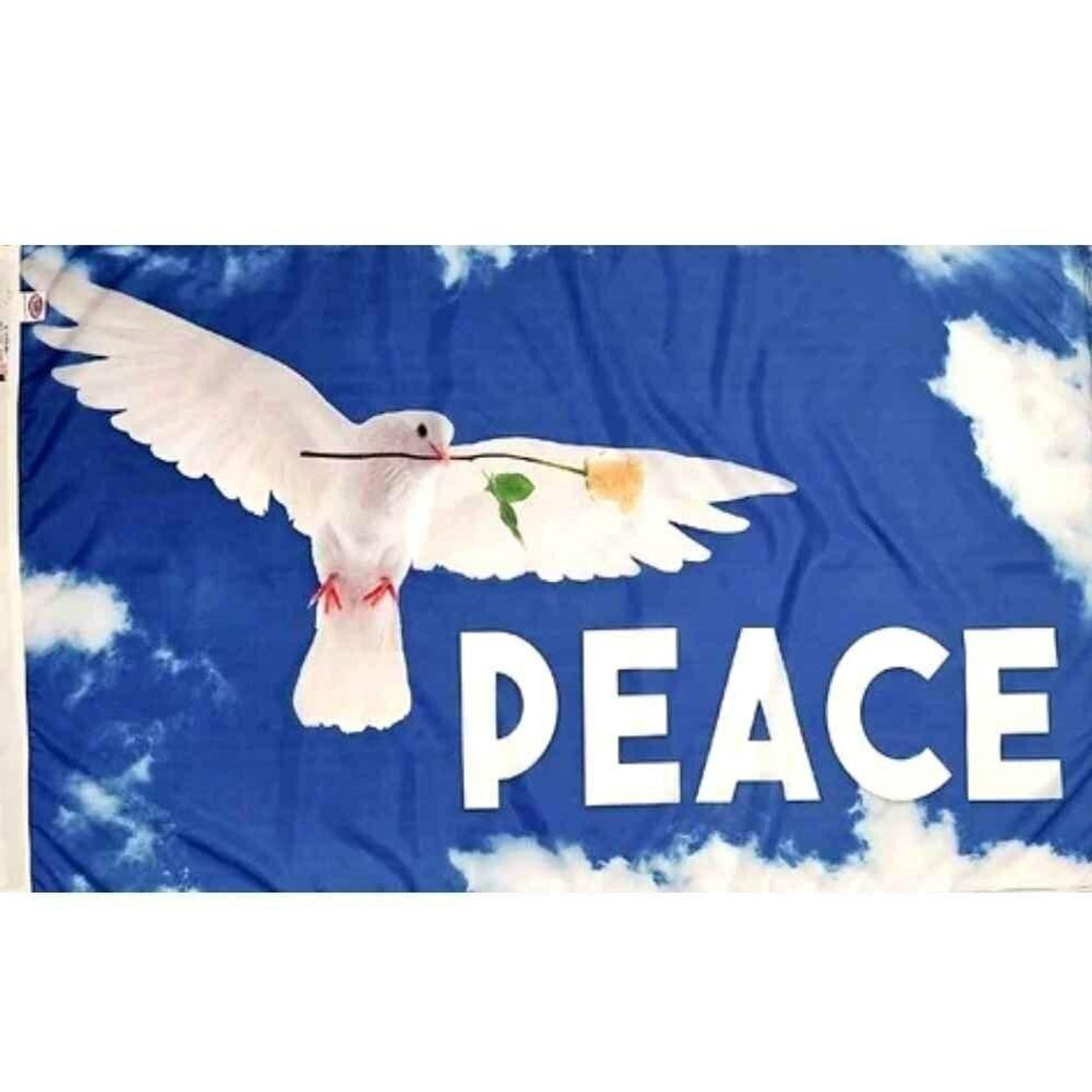 The Peace Dove flag has a sky blue background with white clouds and a white peace dove and lettering in the forefront.