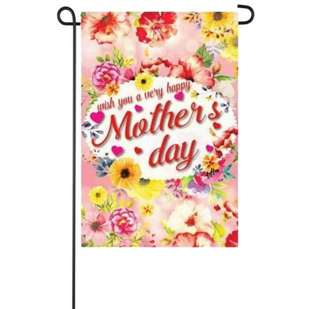 """This garden flag features a light pink background with assorted flowers throughout it. In the center is a white oval that reads """"Wish you a very happy Mother's day"""" in red text."""