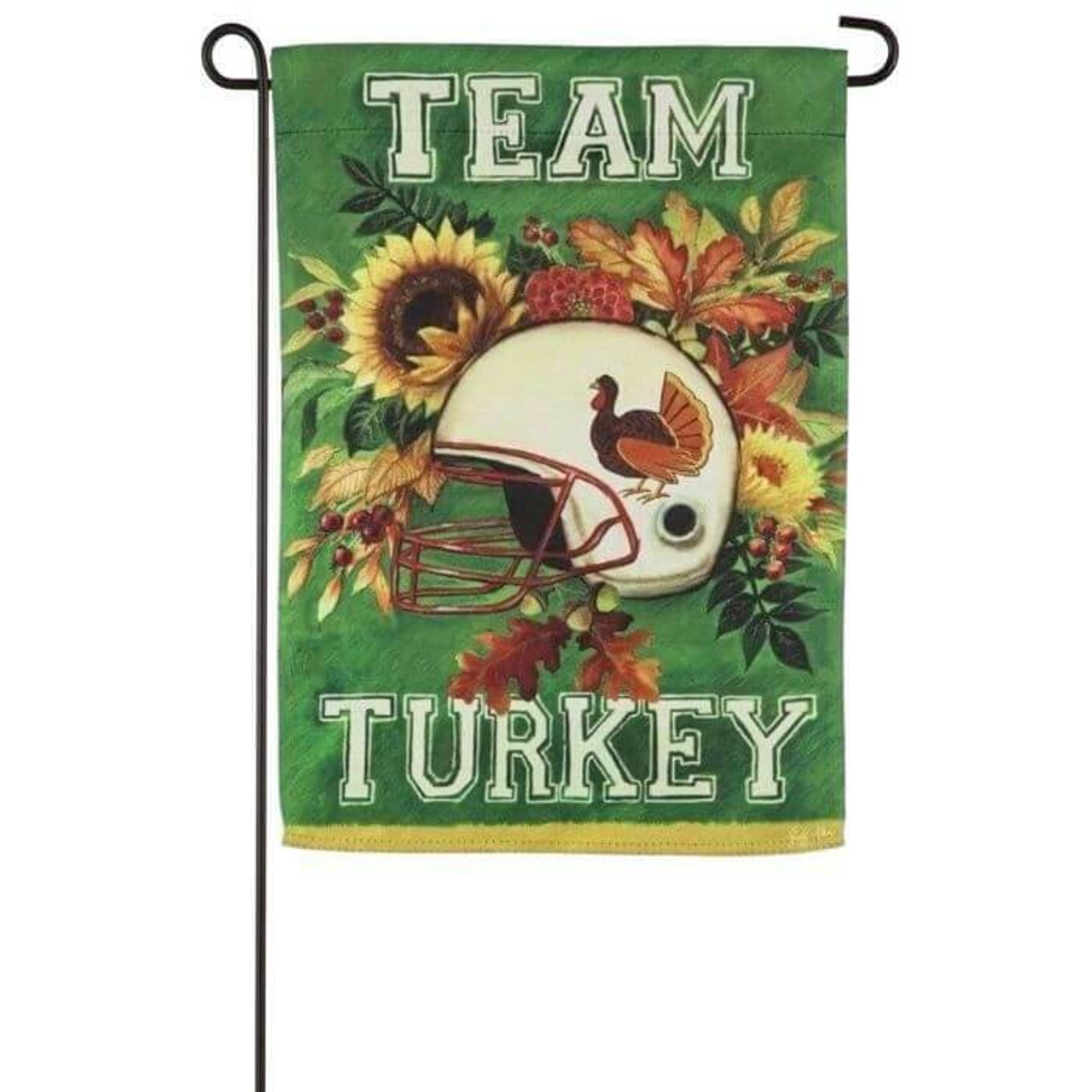"""The Team Turkey Garden Flag features a green background with yellow, orange, and green leaves, sunflowers, and mums. In the middle of the array of flowers and leaves is a white football helmet with the picture of a turkey on it. At the top of the flag is the word """"TEAM"""" in white varsity-like text, and at the bottom is """"TURKEY"""" in the same font."""