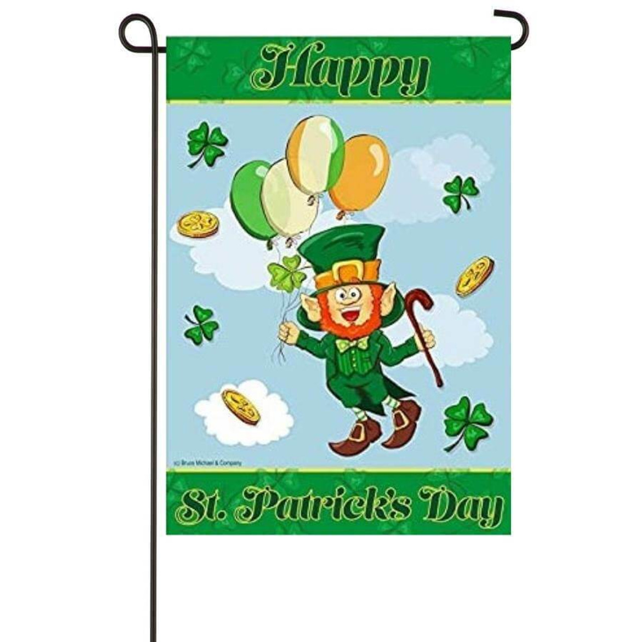 """A St. Patrick's Day garden flag. A leprechaun is in the middle, floating through a blue sky with white clouds. He is holding balloons that are the colors of the Irish flag. Around him are gold coins and green shamrocks. The top and bottom of the flag have a horizontal green stripe. The top says """"Happy,"""" and the bottom says """"St. Patrick's Day."""""""