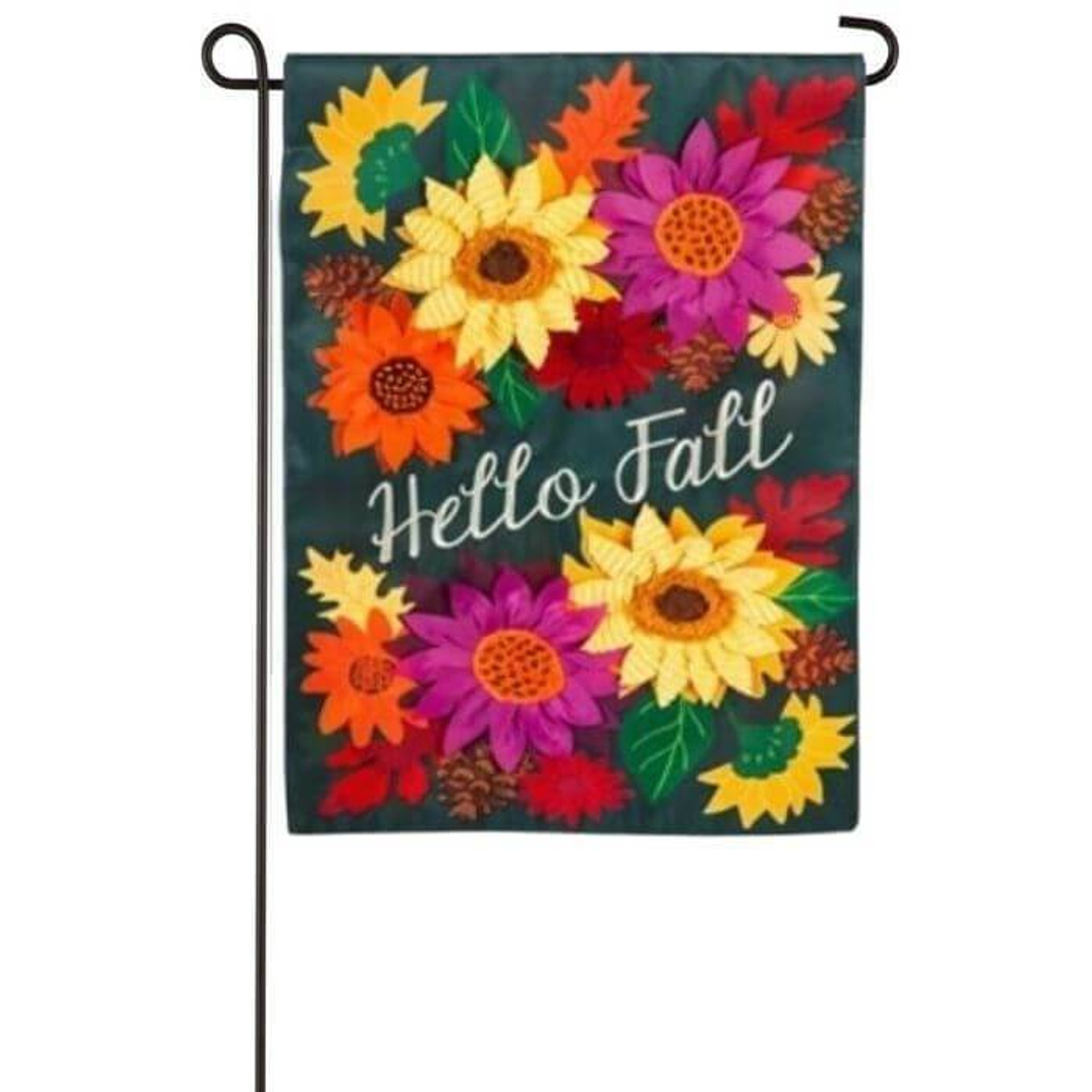 This Hello Fall Garden flag displays an embroidered 'Hello Fall' white text at the center of the flag. There are appliquéd sunflowers and leaves in various colors surrounding the text. Flower colors are orange, yellow, red, and magenta. Leaf colors are green, orange, and red. The background of the flag is black. The flag is displayed on a black garden pole sold separately.