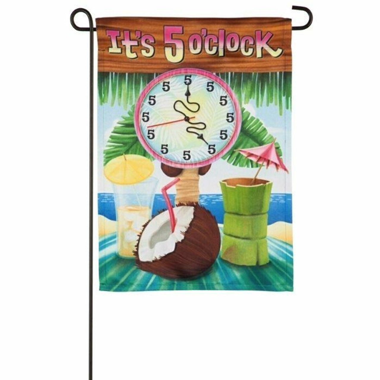 """This garden flag features the beach in the background with a palm tree. There is a blue towel in the middle of the flag with a coconut drink, and two other cocktails with umbrellas in them. There is a clock with all 5's on the face and above the clock is the text """"It's 5 o'clock."""""""