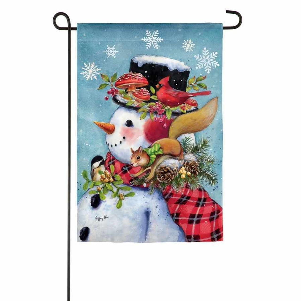 A flag with a side view of a snowman wearing a top hat and a scarf. On his shoulders are acorns, a squirrel wearing a scarf, and a bird. A red bird, mushrooms, and mistletoe are on the brim of him hat.  The background is a light blue with white snowflakes.