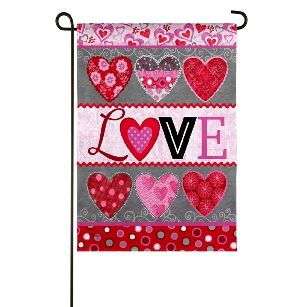 "The garden flag is separated in to five sections. The first section, at the top, has a light pink background with hearts of different sizes in dark pink, red, light gray, and dark gray throughout. The second section has a dark gray background with 3 large hearts in a row. The first heart is red with pink flowers, the second heart is collage of different patterns, and the third heart is red with a damask design. The third section has a light pink background with the word ""LOVE"" written in different fonts for each letter. The L is a dark red script, the O is a red and pink heart, the V is a black block letter, and the E is pink in a Serif font. The fourth section is the same at the second with 3 hearts in a row. The last section has a red background with polka-dots that are white, pink, gray, and dark pink."