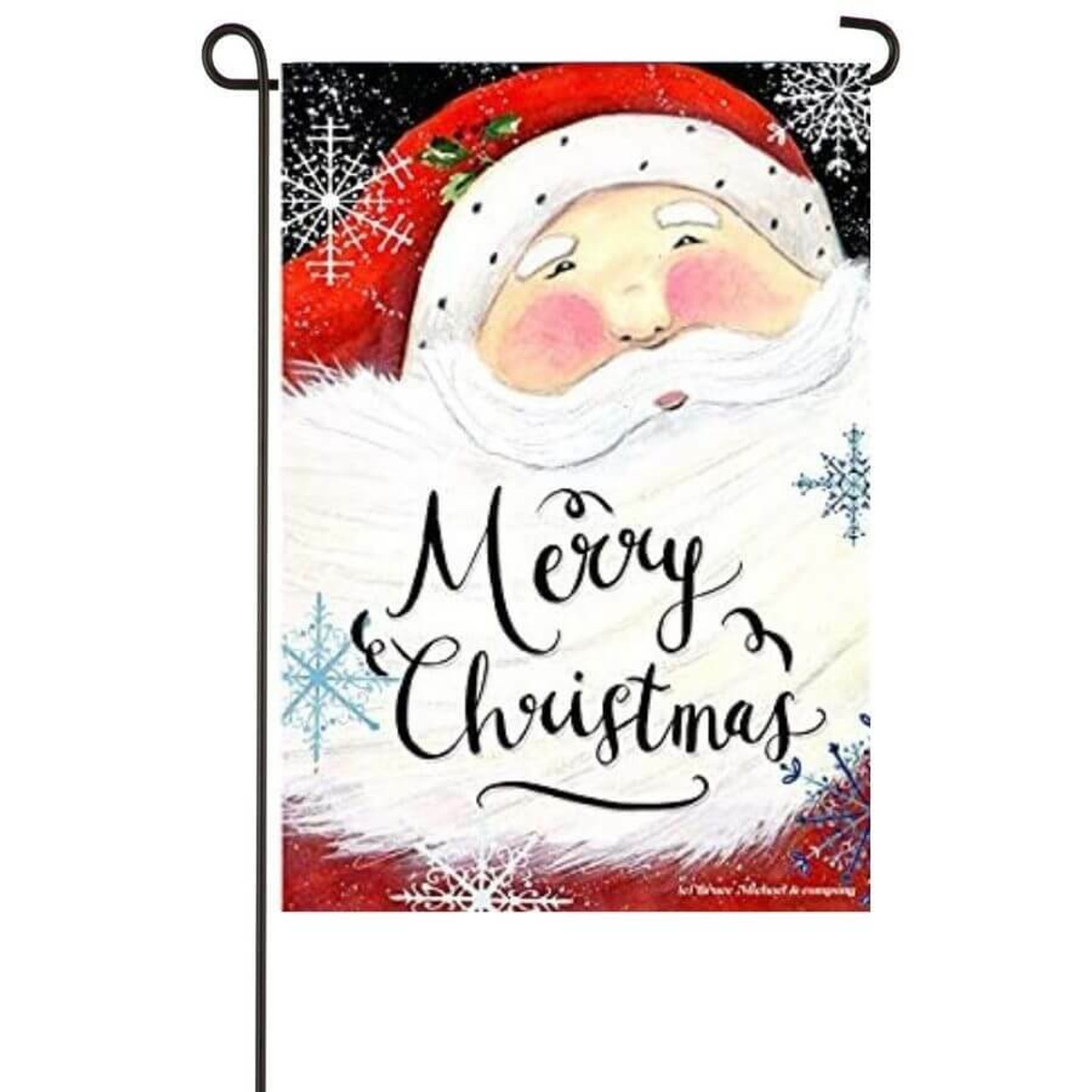 """A garden flag with artwork of Santa's face and """"Merry Christmas"""" written in his beard. Snowflakes are scattered around him."""
