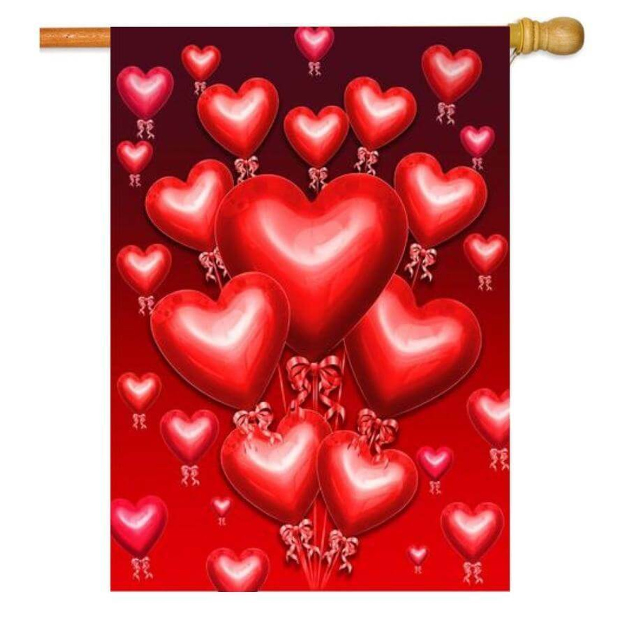 House flag with red heart balloons on a red background that fades into a darker red on the top.
