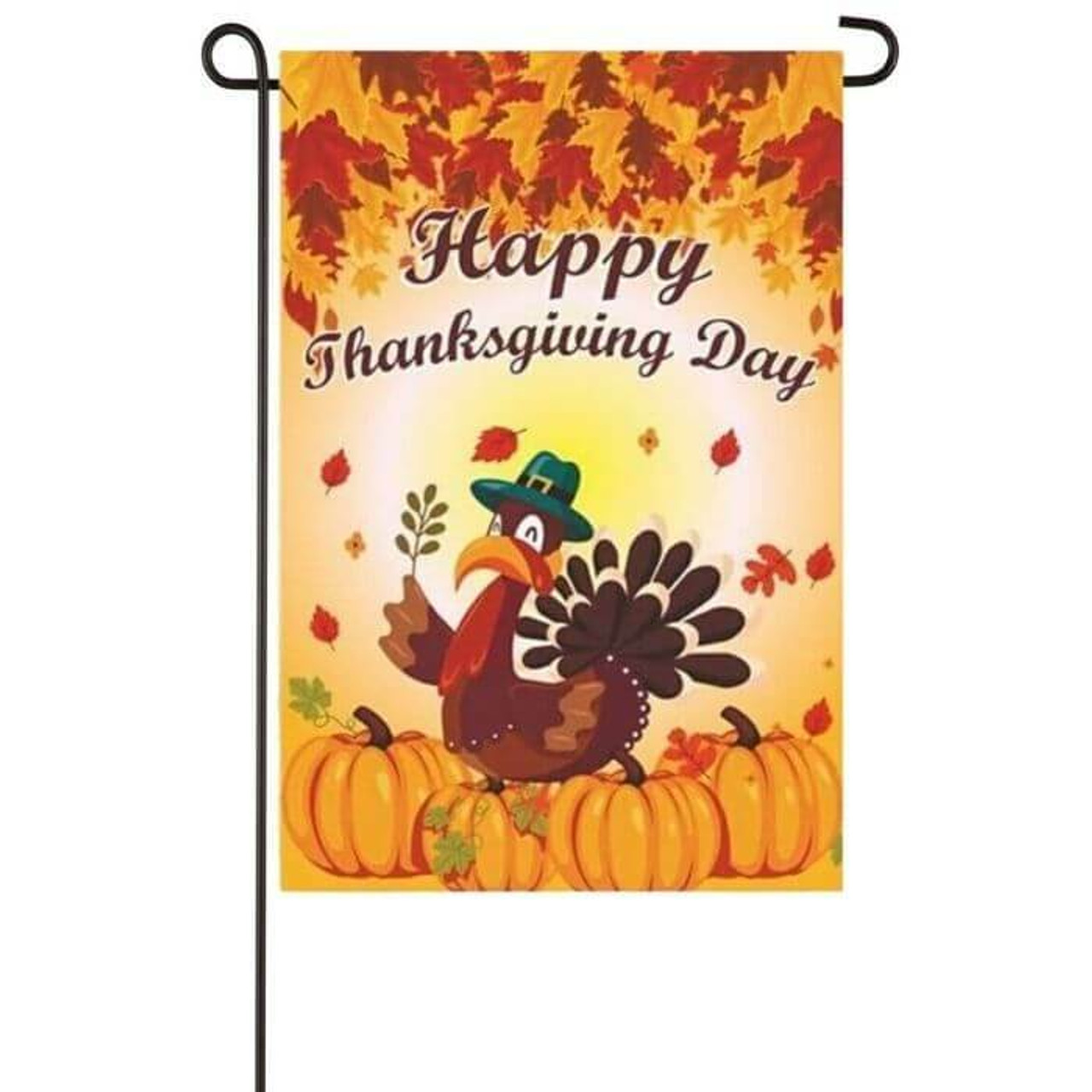 """This garden flag has an orange background with different colored leaves at the top and pumpkins at the bottom with a turkey sitting on top o them. The turkey is wearing a green top hat while holding a leaf and above the turkey, it says """"Happy Thanksgiving Day!"""" in brown."""