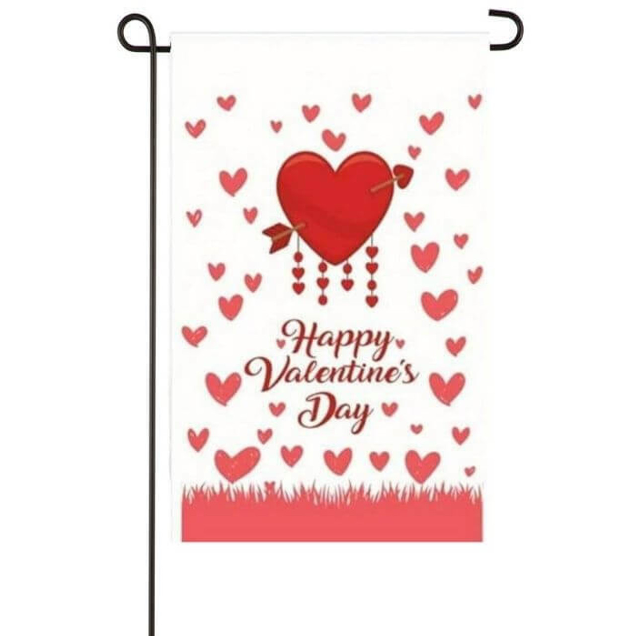 """This garden flag has a white background with small pink hearts throughout. In the center is a red heart with an arrow through it and underneath is says """"Happy Valentine's Day"""" in a script-like font in red."""