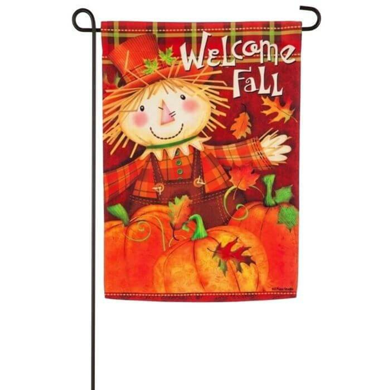 """Scarecrow garden flag with orange background with a cute scarecrow on a pumpkin and the words """"Welcome Fall""""."""