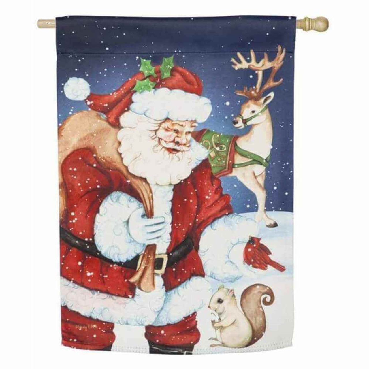 Classic jolly Santa, with a holly sprig in his hat and a bag of presents over his shoulder, smiling at a small squirrel  in the falling snow as a reindeer looks at them from the background.  The sky is a navy blue and freshly fallen snow lies on the ground.