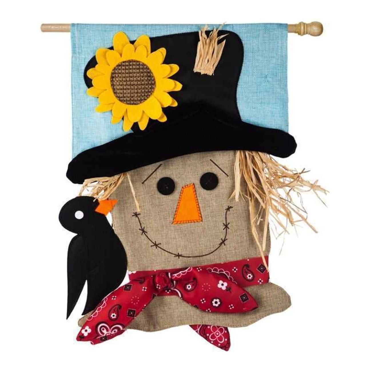 """The Scarecrow Applique house flag measures 44"""" long by 28"""" wide.   It is a shaped burlap house flag featuring a scarecrow bust with a black crow perched on its shoulder.   The  black eyes, orange rectangular nose,  bright yellow sunflower decorating his black hat and crow are felt.  A red bandana around his neck is an actual bandana.  He has faux straw hair and a brown cross-stitched smile."""