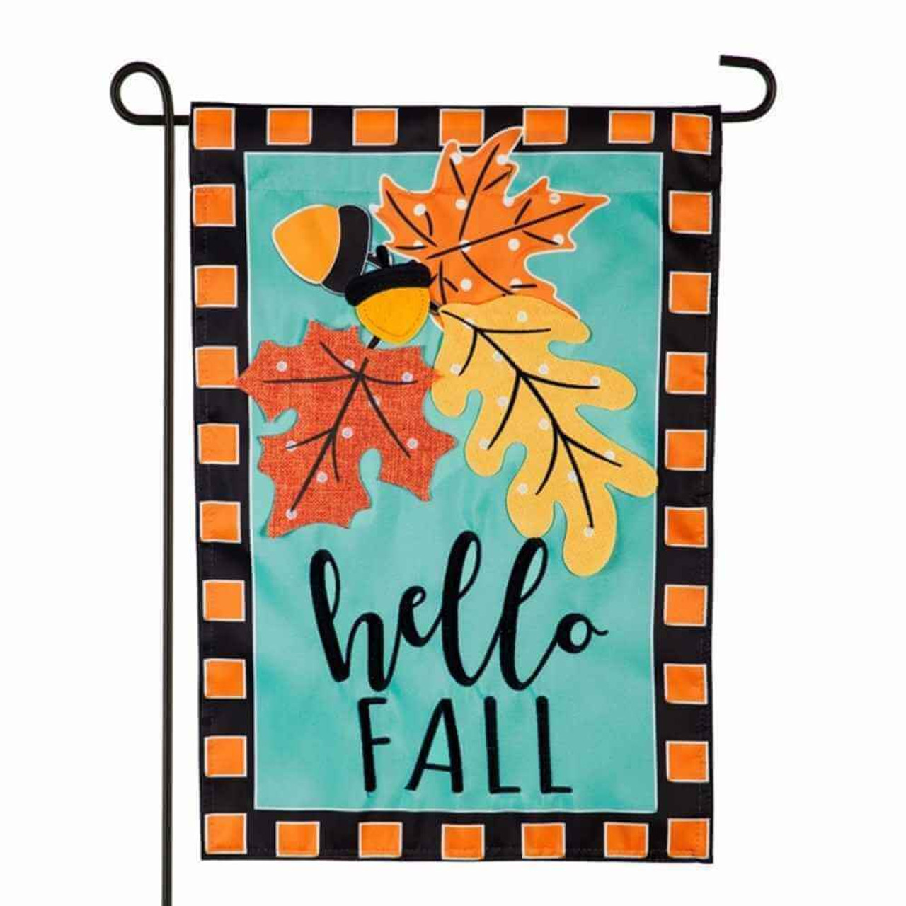 """The Hello Fall garden flag measures 12.5"""" wide by 18"""" tall. The fall flag features 3 fall leaves, burnt orange, tangerine orange and goldenrod yellow and 2  brown acorns individually appliqued to a turquoise sky blue background.  Below the fall fauna bouquet are the words hello in script and fall in block lettering.  The garden flag is surrounded by a black frame  with orange squares patterned onto it. Flag is shown on a black garden flagpole."""