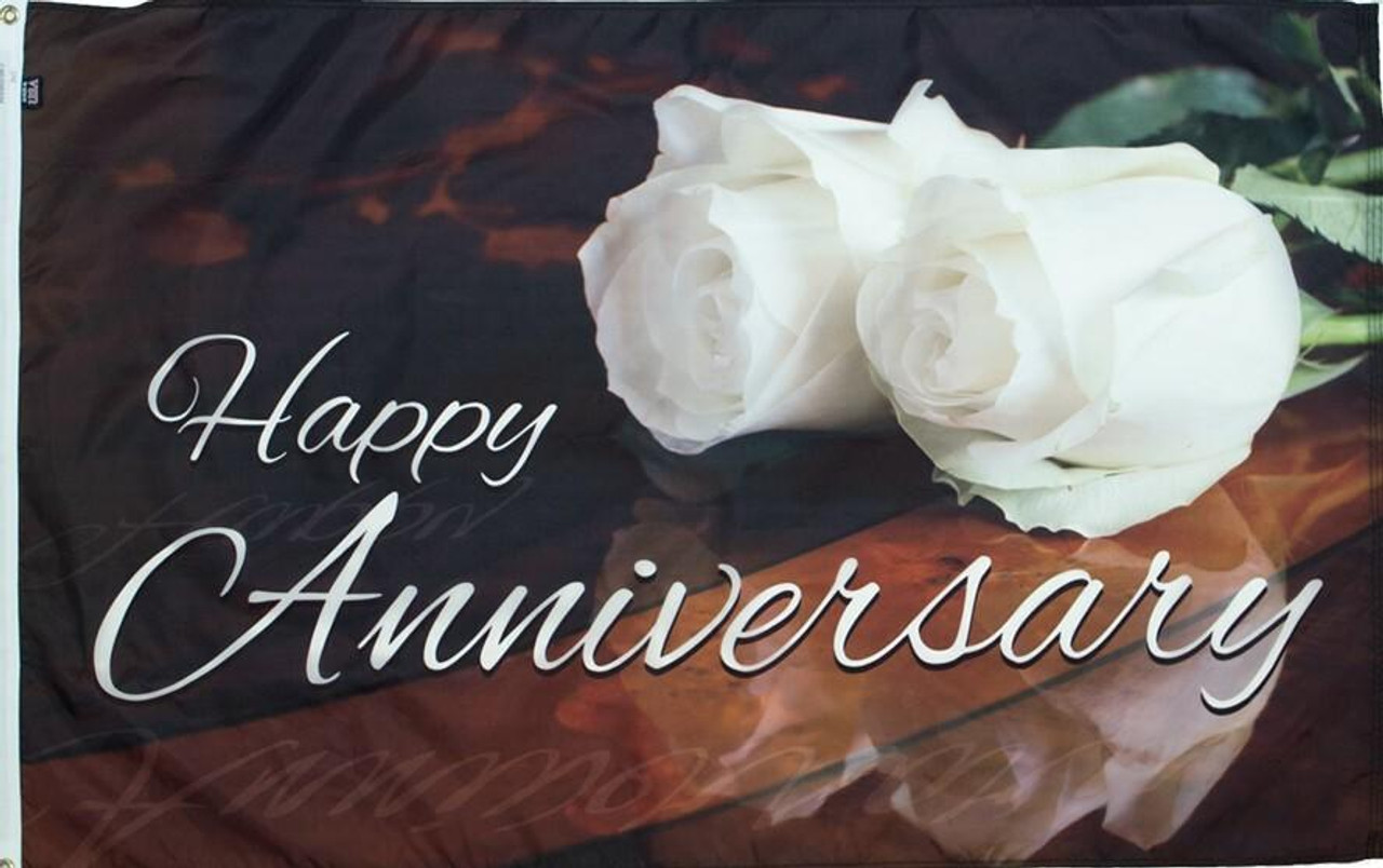 This anniversary flag is highlighted by two white roses and the words Happy Anniversary in white lettering