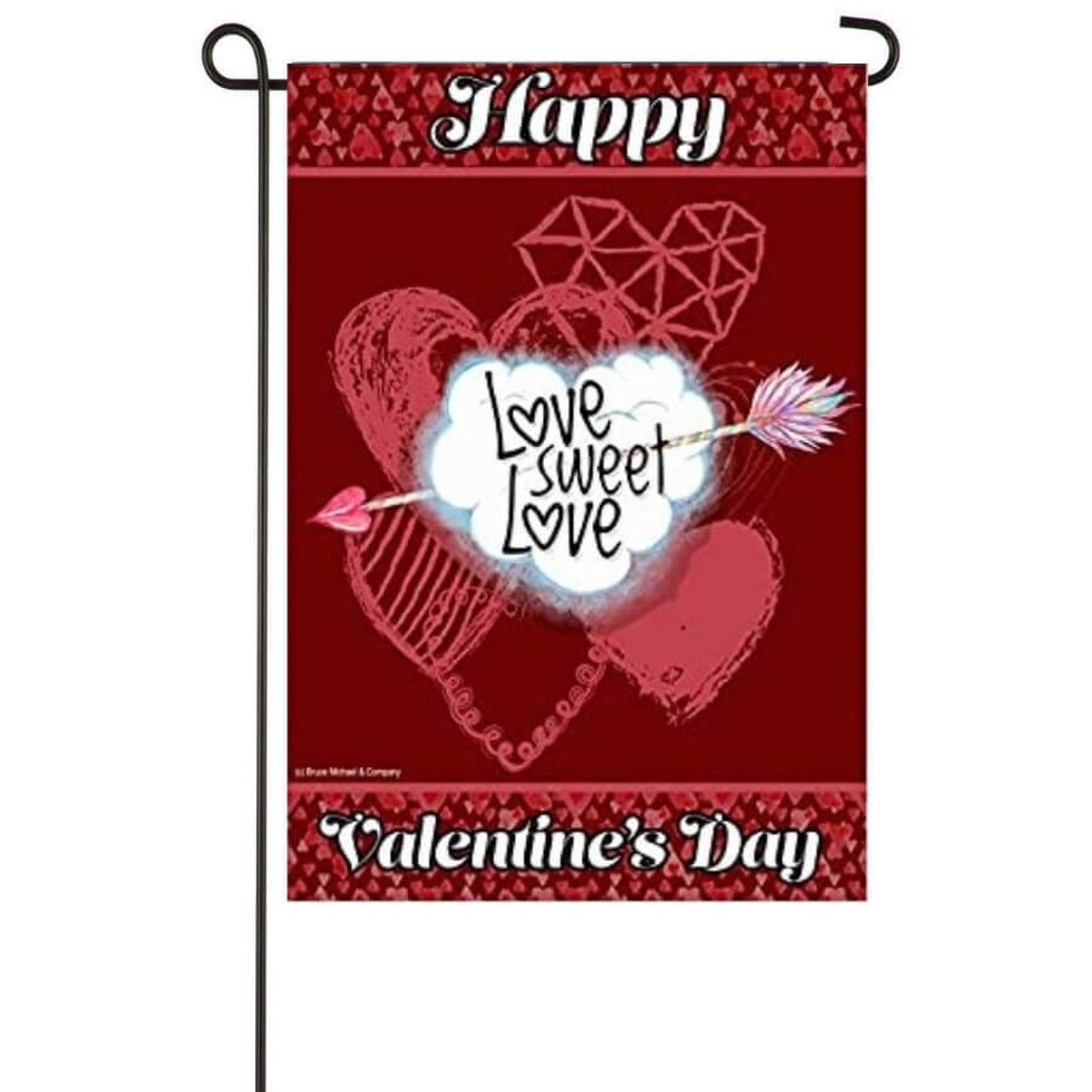 """A red flag. The middle has a cloud-shaped heart that says """"Love Sweet Love"""" with an arrow through it. Multiple light red hearts are behind it. The top of the flag says """"Happy,"""" and the bottom days """"Valentine's Day."""""""