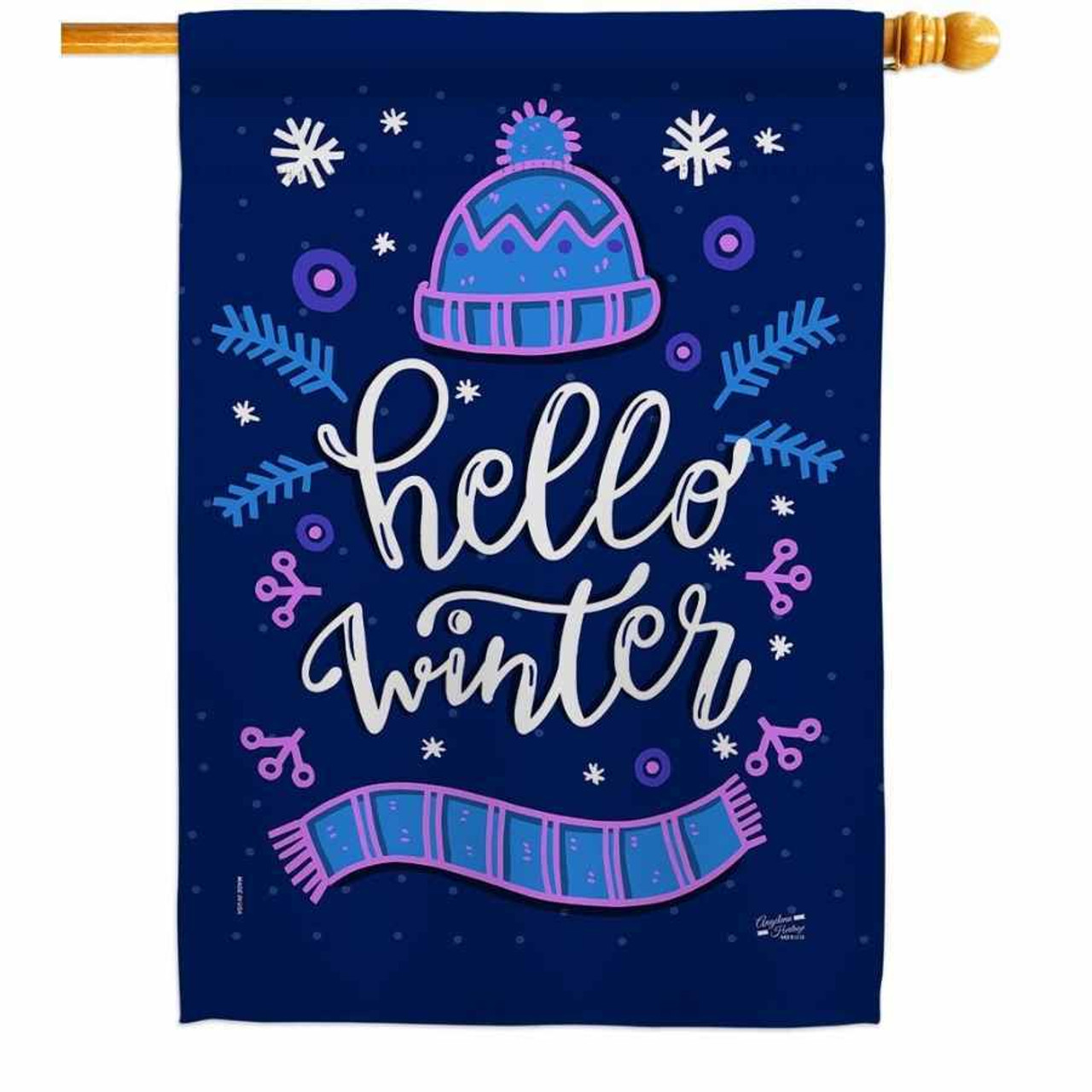 """A dark blue house flag that says """"Hello Winter"""" in the middle in white. Above the words is a wool hat and below the words is a matching scarf."""
