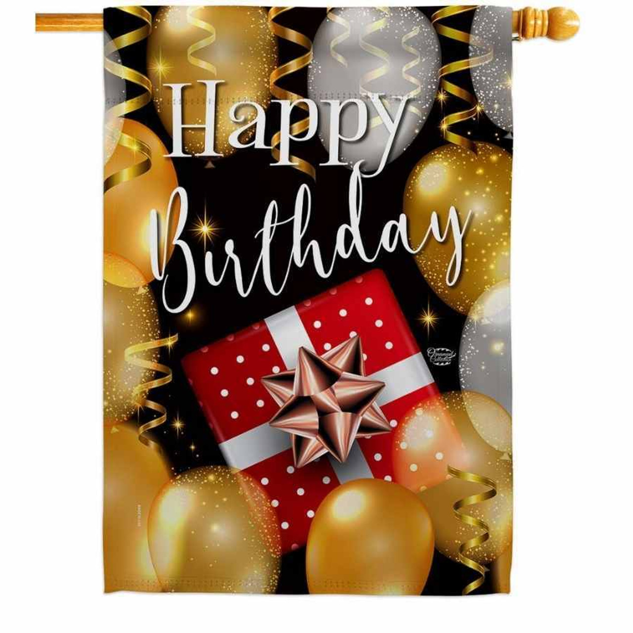 """A house flag that has a white """"Happy Birthday"""" in the middle with a red and white present below it. Around the boarder is a bunch of silver and gold balloons."""