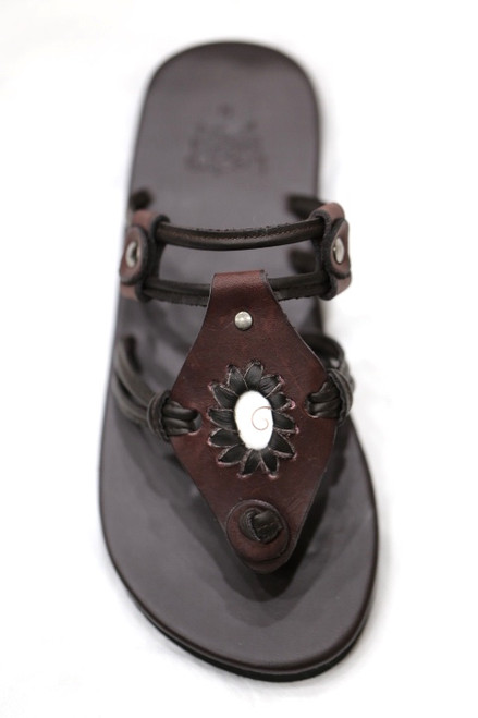 Shiva Sandal Features a stunning shiva Eye shell this design can be worn as a slide or sandal simply by sliding the leather toggles  to the bottom of the sandal separating the 2 foot bands to convert to a heel strap. These sandals provide a light, stylish comfort your feet will absolutely love